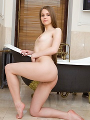 Kristel takes off her autumn clothes and warms herself indoors by showcasing her hot, nubile body.