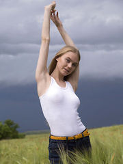 She has an amazing body with natural breasts you would not believe exist and she loves the wind under her teen pussy.