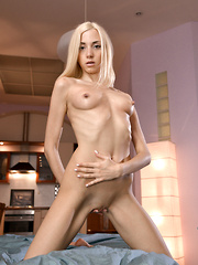 Petite blonde Foxy M shows her little boobs and soft shaved pussy
