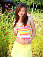 Hot brunette babe gets wild and shows off her beauty among some beautiful flowers to earn that title herself.