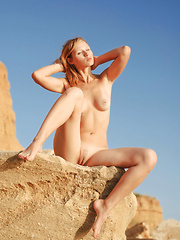 See how this amazing blonde shows off her perfect breasts and body in hot unusual positions to the camera.
