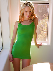 Cute blonde Sara James in green dress candidly spreading her pussy