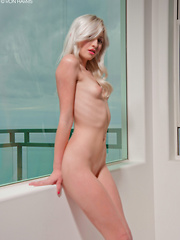 Beautiful blonde Layden Sin removes her skimpy clothes flashing her cute, perky tits and slender body