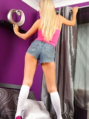 Lucy Anne shows off her shapely legs in her cropped denim hotpants and knee high socks