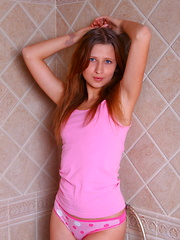 Skinny teenage wonder slowly strips all her clothes and gives a nice striptease in the bathtub just for you.